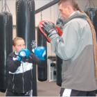 Hands up: Ryan Henry runs boxing exercises with his daughter Zsana at the New Zealand Fight and...