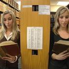 Identical twins Alexandra (left) and Sara Isherwood (23), who will practise law with different...