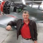 Pilot programmer . . . John Lamont relaxes next to a Russian Lavotchkin warbird. Photo by Matthew...