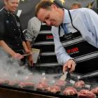 Meat and greet . . . National Party leader John Key minds the lamb at the Upper Clutha A and P...