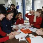 Lilian Flores (left) is taught a maths game by her daughter, Sofia Yanez (10), at Musselburgh...