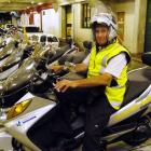 Parking officer Brian Benson, back at work yesterday after his scooter was let loose in Albany...