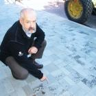 Queenstown Lakes District Council roading manager Ian Marshall points to broken tiles outside the...