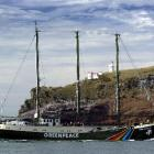 The Rainbow Warrior slips past Taiaroa Head to enter the Otago Harbour. Photo by Gerard O'Brien.