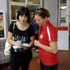 Sasha Ward-Faint (18) (left) fills out an enrolment form assisted by Lucy McAuliffe (21) from...