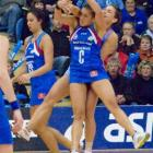 Southern Steel centre Liana Barrett-Chase battles for possession with her Northern Mystics...