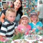 Surrounded by colour: Checking out some of the brightly-decorated home industry items on display are Narelle Garrick with children (from left) Lachlan (9) and Samantha (7) and friend Teegan Danielson (7).