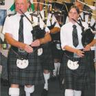 The skirl of the pipes: Alex Joyce, of Alexandra, and Beth Black, of Cromwell, lead the Alexandra...