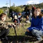 Warrington School pupils Steven Rainbow (10) and sister Aimee-Leigh (12) work on a miniature wind...