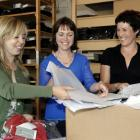 Recycled . . . Working through recycling cardboard are (from left): Silkbody director Emily...