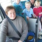 Graeme, Matthew (8), Caleb (7) and Ella (4) Taylor line up for one of Indy Gard's last bus runs....