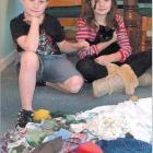 Feline thief: Jessie (9, left) and Sammy (12) Irvine with Roxy and her stolen bounty.