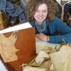 Jenny Lacey shows off the book she created using possum skin and totara wood. Photo by Sally Rae.
