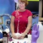 New Zealand-born biochemist Dr Jilly Evans expresses her passion for science with a flying glove...