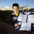 Alex Timmings (9) at the site of the Awatea St stadium with his petition in support of the...