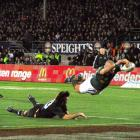Springbok winger Ricky Januarie scores the winning try  in the Tri-Nations test at Carisbrook on...