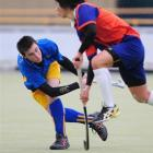 Otago's Cal Freeman (left) hits a ball past Tauranga's Hin Siang Tay during their match in the...