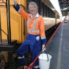 """Taieri Gorge Railway assistant guard Judy Mann prepares carriages for today's """"suburban rail..."""