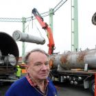 Bob Bradshaw, a former plant operator at the Dunedin City Gasworks, watches as gas-making...