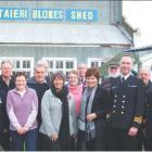 Sign of the times: Members of the Dunedin Blokes' Shed steering committee and the interim...