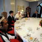 Pope Benedict XVI sits with youths during a lunch at St. Mary Cathedral house, in Sydney today....