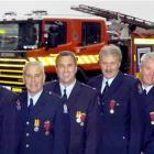 Dunedin firefighters, from left, John Griffiths, Richard Huuskes, Jock Mackay, Greg Casey, Murray...