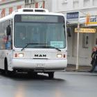 The campus circuit bus turns into George St yesterday with two passengers on board. Photo by...
