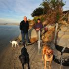 Bruce and Ruth McLean with their dogs (from left) Hope, Meg and Pip beside their recently...