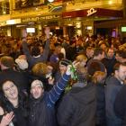 A crowd gathers in the Octagon after the test to continue the celebrations. Photos by Peter...