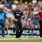 Adam Milne of New Zealand celebrates the wicket of Dimuth Karunaratne of Sri Lanka. Photo by...