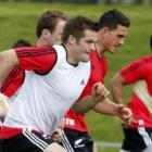 All Blacks captain Richie McCaw runs during a team training at Trusts Stadium in Auckland. Photo...