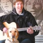 Bevan Gardiner, with guide dog Denim, gets ready for his lead role in the John Denver tribute...