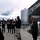 Bryan Beeston speaks to North Island farmers during the technology tour. His daughter Frances is...