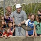 Checking out smolt at the Dunedin Community Salmon Hatchery in Sawyers Bay yesterday are Sawyers...