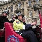 Fire Engine Restoration Society members (front seat, from left) Keith Ferris, Paul Clements, ...