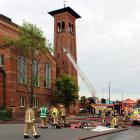 Firefighters work in the fireground at Invercargill's First Presbyterian Church yesterday.