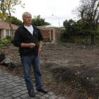 Karl Lau weighs his options next to the spot his B&B  stood. The building was demolished after...