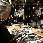 Margarita Robertson sorts through NOM*d archival photographs.