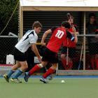Northern player James Coughlan (left) and Canterbury skipper Tom Loudon jostle for possession as...