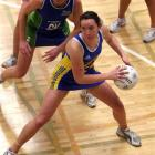 Otago goal shoot Grier Campbell eyes the hoop as Auckland Waitakere goal keep Kate Dowling looms...