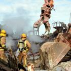 Two diggers and a team of firefighters were still at work on the Livestock Supplies fire in Gore...