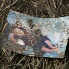 A baby picture lies on the ground covered in mud Wednesday September 30, 2009 -- one of the...