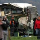 A badly damaged bus pictured at the scene of an accident involving a school bus and a logging...