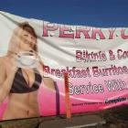 A banner is shown outside a suburban Denver coffee shop called Perky Cups. Officials say a bikini...
