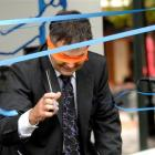A blindfolded Dunedin Mayor Dave Cull cuts the ribbon to open the 2011 Dunedin Fringe Festival...