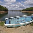 A boat is seen out of water on the dam reservoir of Santa Clara a Velha in southern Portugal....