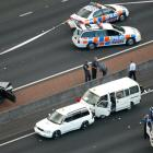 A body lies in the back of a white van on the Northwestern Motorway near St Lukes interchange...