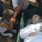A boy reacts next to the body of Mamoun Al-Masalmeh whom activists say was killed by forces loyal...