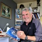 """A """"chuffed"""" Ken Tustin takes a look at his newly-arrived book about the history of moose in New..."""