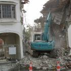A contractor demolishes a building on Tennyson St to make 
